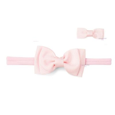 faixa-de-cabelo-com-laco-rosa-bebe